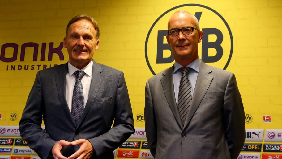 DORTMUND, GERMANY - AUGUST 21:  (L-R) Hans Joachim Watzke, chairman of the board and Thomas Tress, financial manager attend  the press briefing on the annual results of Borussia Dortmund at Signal Iduna Park on August 21, 2015 in Dortmund, Germany.  (Photo by Christof Koepsel/Bongarts/Getty Images)