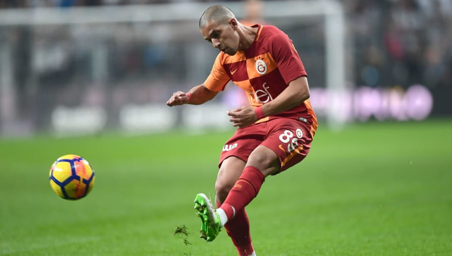 (FILE) This file photograph taken on December 2 , 2017, shows Galatasaray's French born Algerian midfielder Sofiane Feghouli as he kicks the ball during the Turkish Super Lig football match between Besiktas and Galatasaray at Vodafone Park Stadium in Istanbul.   It's a common sight that has become a ritual. A foreign player set to sign for a Turkish side steps bleary-eyed into the arrivals hall at Istanbul airport to be greeted by a raucous welcome from thousands of fans. It's a baptism of fire for the large numbers of European and Latin American stars who have arrived to ply their trade in the Super Lig in recent years, attracted by high wages, low taxes and a competitive league. / AFP PHOTO / OZAN KOSE        (Photo credit should read OZAN KOSE/AFP/Getty Images)