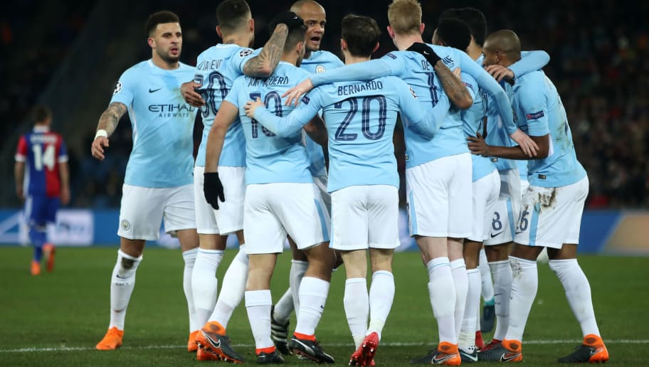 BASEL, SWITZERLAND - FEBRUARY 13:  Sergio Aguero of Manchester City celebrates after scoring his sides third goal with his Manchester City team mates during the UEFA Champions League Round of 16 First Leg  match between FC Basel and Manchester City at St. Jakob-Park on February 13, 2018 in Basel, Switzerland.  (Photo by Alex Grimm/Bongarts/Getty Images )