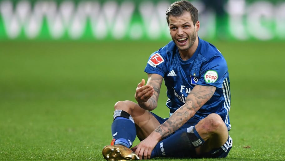 AUGSBURG, GERMANY - JANUARY 13: Dennis Diekmeier of Hamburg sits on the pitch and gestures during the Bundesliga match between FC Augsburg and Hamburger SV at WWK-Arena on January 13, 2018 in Augsburg, Germany. (Photo by Sebastian Widmann/Bongarts/Getty Images)