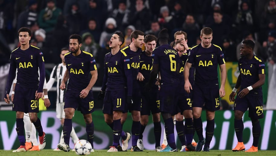 Tottenham Hotspur's Danish midfielder Christian Eriksen (4R) celebrates with teammates after scoring his team's second goal during the UEFA Champions League round of sixteen first leg football match between Juventus and Tottenham Hotspur at The Allianz Stadium in Turin on February 13, 2018.  / AFP PHOTO / Marco BERTORELLO        (Photo credit should read MARCO BERTORELLO/AFP/Getty Images)