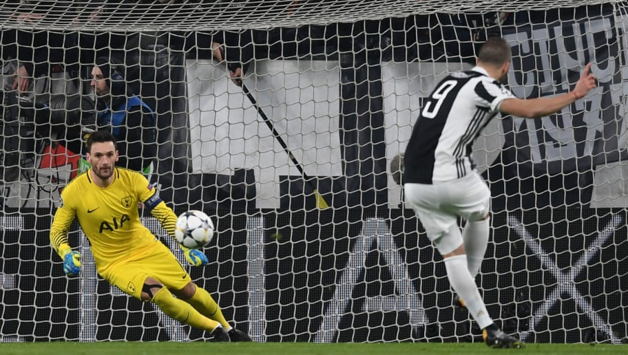 TURIN, ITALY - FEBRUARY 13:  Gonzalo Higuain of Juventus scores his sides second goal past Hugo Lloris of Tottenham Hotspur during the UEFA Champions League Round of 16 First Leg  match between Juventus and Tottenham Hotspur at Allianz Stadium on February 13, 2018 in Turin, Italy.  (Photo by Michael Regan/Getty Images)