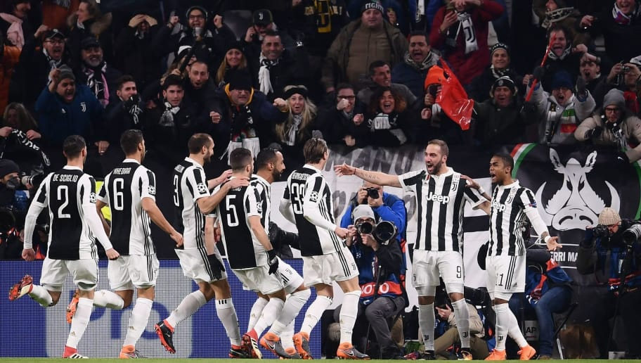 Juventus' forward from Argentina Gonzalo Higuain (2R) celebrates with teammates after scoring during the UEFA Champions League round of sixteen first leg football match between Juventus and Tottenham Hotspur at The Allianz Stadium in Turin on February 13, 2018.  / AFP PHOTO / Marco BERTORELLO        (Photo credit should read MARCO BERTORELLO/AFP/Getty Images)