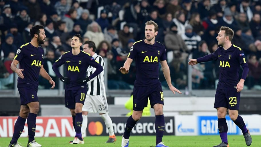 Tottenham Hotspur's English striker Harry Kane (C) celebrates scoring his team's first goal during the UEFA Champions League round of sixteen first leg football match between Juventus and Tottenham Hotspur at The Allianz Stadium in Turin on February 13, 2018.  / AFP PHOTO / MIGUEL MEDINA        (Photo credit should read MIGUEL MEDINA/AFP/Getty Images)