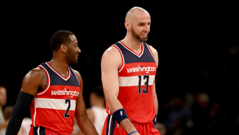 NEW YORK, NY - APRIL 06:  John Wall #2 and Marcin Gortat #13 of the Washington Wizards celebrate during a time out against the New York Knicks at Madison Square Garden on April 6, 2017 in New York City. NOTE TO USER: User expressly acknowledges and agrees that, by downloading and or using this Photograph, user is consenting to the terms and conditions of the Getty Images License Agreement  (Photo by Elsa/Getty Images)