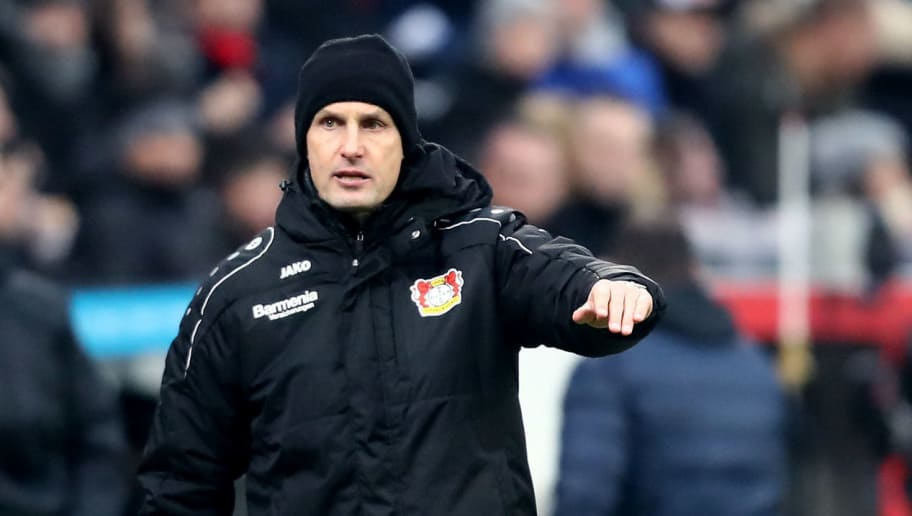 LEVERKUSEN, GERMANY - FEBRUARY 10:  Head coach Heiko Herrlich of Leverkusen issues instructions during the Bundesliga match between Bayer 04 Leverkusen and Hertha BSC at BayArena on February 10, 2018 in Leverkusen, Germany. (Photo by Christof Koepsel/Bongarts/Getty Images)