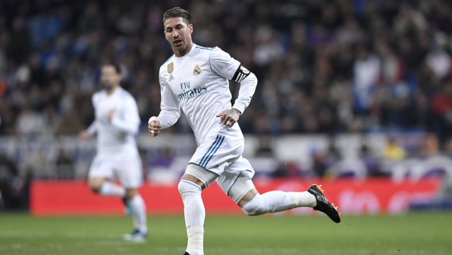 Real Madrid's Spanish defender Sergio Ramos runs with the ball during the Spanish league football match between Real Madrid CF and Real Sociedad at the Santiago Bernabeu stadium in Madrid on February 10, 2018. / AFP PHOTO / GABRIEL BOUYS        (Photo credit should read GABRIEL BOUYS/AFP/Getty Images)