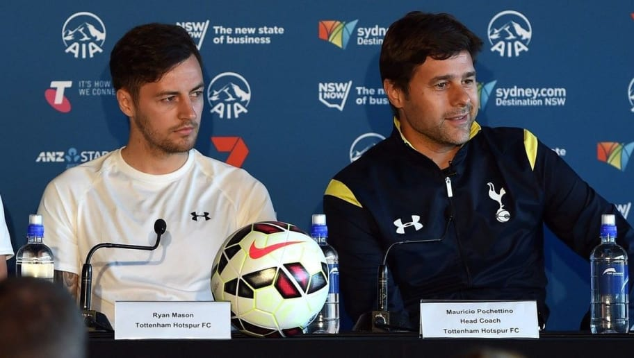 Tottenham Hotspur's head coach Mauricio Pochettino (2nd R) speaks at a press conference as his team's players Harry Kane (2nd L), Ryan Mason (R) and Sydney FC's defender Sebastian Ryall (L) look on in Sydney  on May 28, 2015 as the English Premier League team arrives to take on local team Sydney FC on May 30. Tottenham Hotspur's assistant head coach Jesus Perez is on right. AFP PHOTO / Saeed Khan        (Photo credit should read SAEED KHAN/AFP/Getty Images)