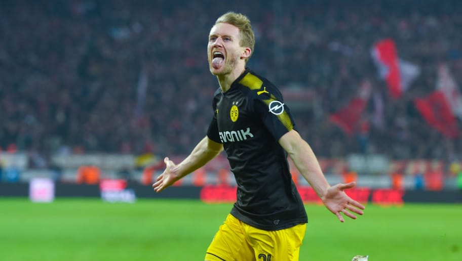 Dortmund's German midfielder Andre Schuerrle celebrates after scoring a goal during the German first division Bundesliga football match FC Cologne versus Borussia Dortmund in Cologne, western Germany, on February 2, 2018. / AFP PHOTO / Patrik STOLLARZ / RESTRICTIONS: DURING MATCH TIME: DFL RULES TO LIMIT THE ONLINE USAGE TO 15 PICTURES PER MATCH AND FORBID IMAGE SEQUENCES TO SIMULATE VIDEO. == RESTRICTED TO EDITORIAL USE == FOR FURTHER QUERIES PLEASE CONTACT DFL DIRECTLY AT + 49 69 650050         (Photo credit should read PATRIK STOLLARZ/AFP/Getty Images)