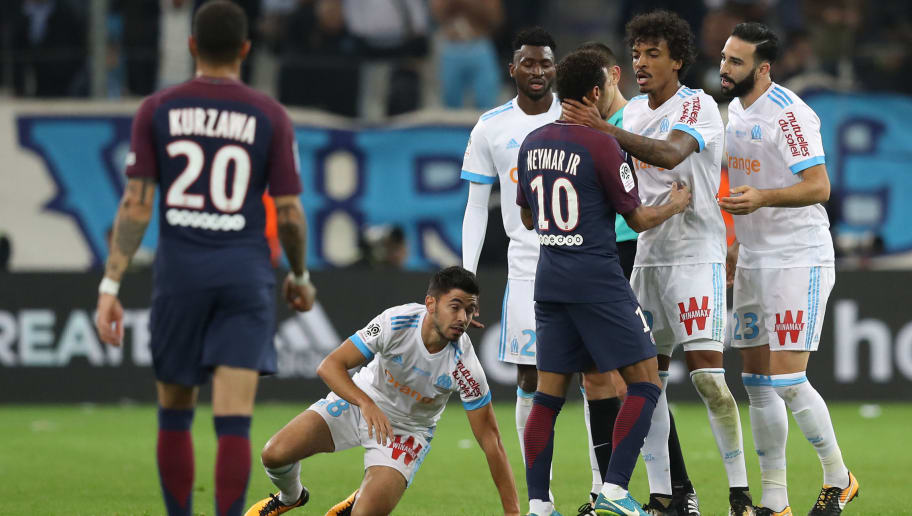 Paris Saint-Germain's Brazilian forward Neymar (3R) argues with Marseille's Brazilian midfielder Luiz Gustavo (2R) during the French L1 football match between Marseille (OM) and Paris Saint-Germain (PSG) on October 22, 2017, at the Velodrome Stadium in Marseille, southeastern France. / AFP PHOTO / Valery HACHE        (Photo credit should read VALERY HACHE/AFP/Getty Images)