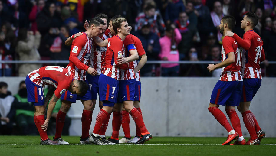 Atletico Madrid's Spanish forward Fernando Torres (2L) celebrates with teammates after scoring a goal during the Spanish league football match between Club Atletico de Madrid and UD Las Palmas at the Wanda Metropolitano stadium in Madrid on January 28, 2018. / AFP PHOTO / OSCAR DEL POZO        (Photo credit should read OSCAR DEL POZO/AFP/Getty Images)