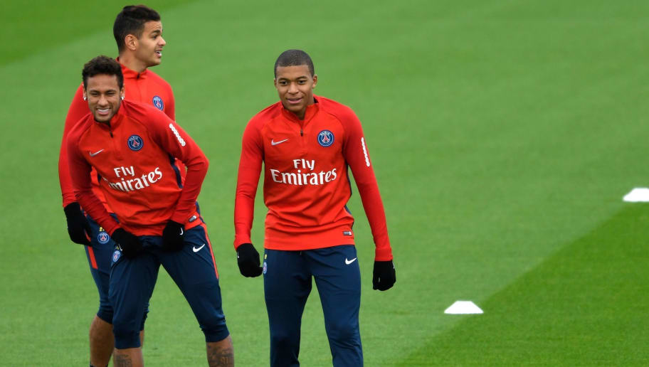 Paris Saint-Germain's French midfielder Hatem Ben Arfa (rear L), Paris Saint-Germain's Brazilian forward Neymar (L) and Paris Saint-Germain's French forward Kylian Mbappe (R) take part in a training session in Saint-Germain-en-Laye, on October 25, 2017.  / AFP PHOTO / BERTRAND GUAY        (Photo credit should read BERTRAND GUAY/AFP/Getty Images)
