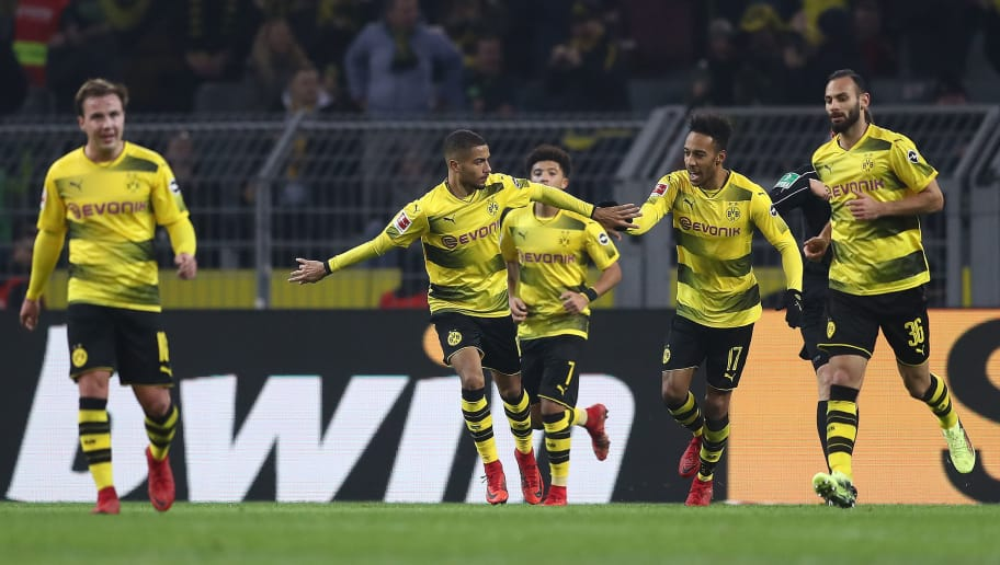 DORTMUND, GERMANY - JANUARY 27: Jeremy Toljan of Dortmund (2n left) celebrates with his team after he scored a goal to make it 2:2 during the Bundesliga match between Borussia Dortmund and Sport-Club Freiburg at Signal Iduna Park on January 27, 2018 in Dortmund, Germany. (Photo by Lars Baron/Bongarts/Getty Images)