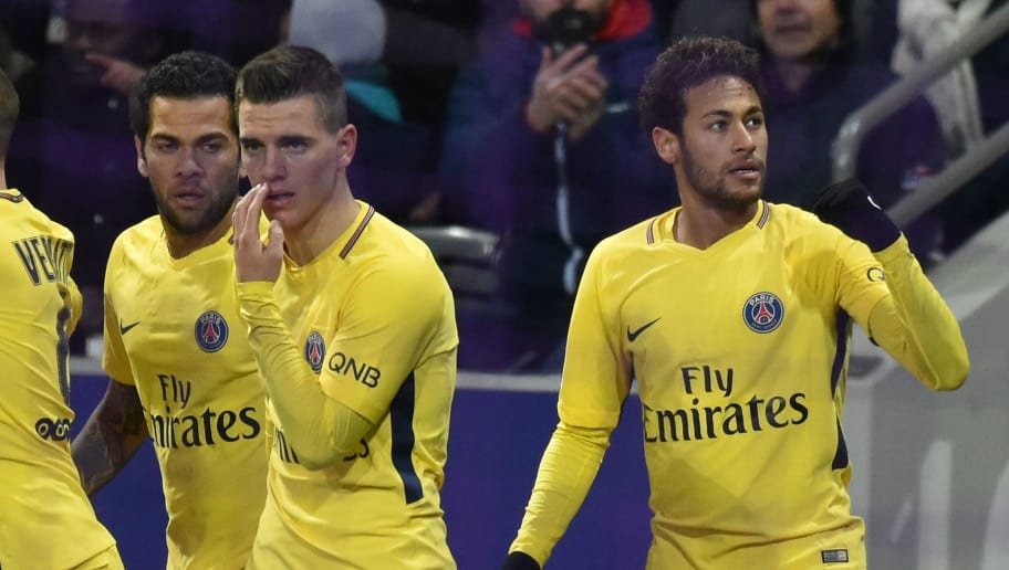 Paris Saint-Germain's Brazilian forward Neymar Jr (R) celebrates with teammates after scoring a goal during the French L1 football match Toulouse versus Paris on February 10, 2018 at the Municipal Stadium in Toulouse, southern France. / AFP PHOTO / PASCAL PAVANI        (Photo credit should read PASCAL PAVANI/AFP/Getty Images)