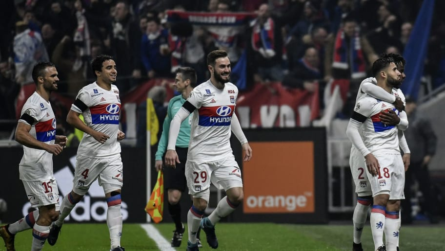 Lyon's French midfielder Nabil Fekir (R) celebrates after scoring a goal during the French L1 football match between Olympique Lyonnais and Paris-Saint Germain (PSG) at Groupama stadium in Decines-Charpieu on January 21, 2018. / AFP PHOTO / JEFF PACHOUD        (Photo credit should read JEFF PACHOUD/AFP/Getty Images)