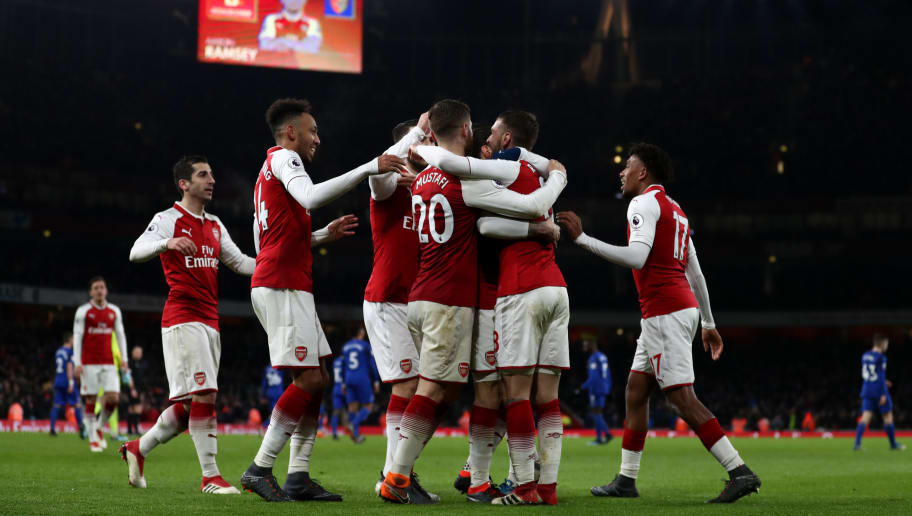 LONDON, ENGLAND - FEBRUARY 03: Aaron Ramsey of Arsenal celebrates after scoring his sides fifth goal and his hat-trick with his team mates during the Premier League match between Arsenal and Everton at Emirates Stadium on February 3, 2018 in London, England. (Photo by Catherine Ivill/Getty Images)