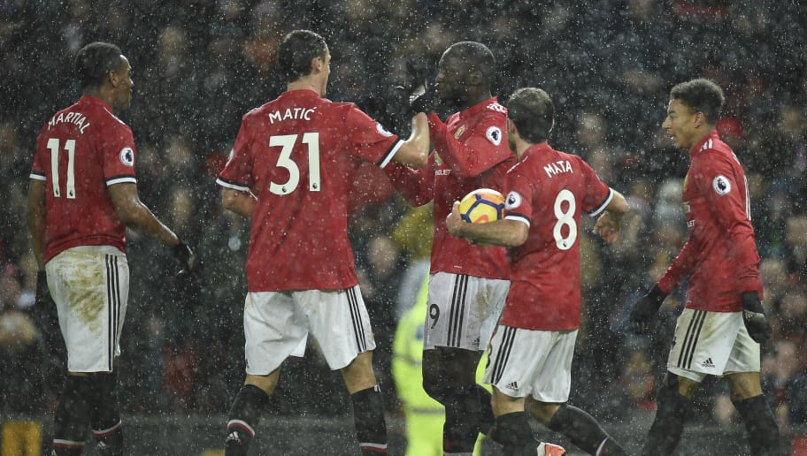 Manchester United's Belgian striker Romelu Lukaku (C) celebrates scoring their third goal during the English Premier League football match between Manchester United and Stoke City at Old Trafford in Manchester, north west England, on January 15, 2018. / AFP PHOTO / Oli SCARFF / RESTRICTED TO EDITORIAL USE. No use with unauthorized audio, video, data, fixture lists, club/league logos or 'live' services. Online in-match use limited to 75 images, no video emulation. No use in betting, games or single club/league/player publications.  /         (Photo credit should read OLI SCARFF/AFP/Getty Images)