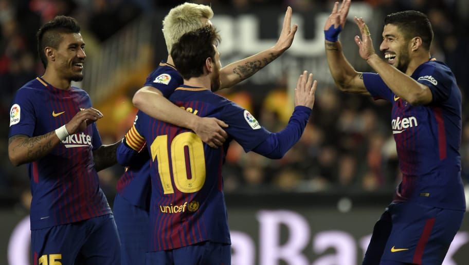 Barcelona's Croatian midfielder Ivan Rakitic (2L) celebrates a goal with Barcelona's Brazilian midfielder Paulinho (L), Barcelona's Argentinian forward Lionel Messi (3L) and Barcelona's Uruguayan forward Luis Suarez during the Spanish 'Copa del Rey' (King's cup) second leg semi-final football match between Valencia CF and FC Barcelona at the Mestalla stadium in Valencia on February 8, 2018. / AFP PHOTO / JOSE JORDAN        (Photo credit should read JOSE JORDAN/AFP/Getty Images)
