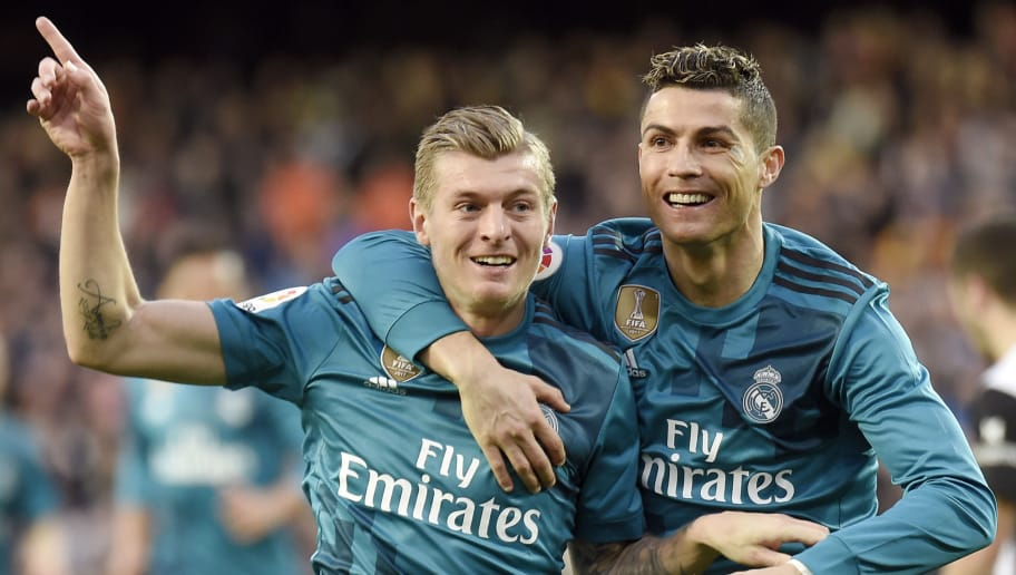 Real Madrid's German midfielder Toni Kroos (L) celebrates a goal with Real Madrid's Portuguese forward Cristiano Ronaldo during the Spanish league football match between Valencia CF and Real Madrid CF at the Mestalla stadium in Valencia on January 27, 2018. / AFP PHOTO / JOSE JORDAN        (Photo credit should read JOSE JORDAN/AFP/Getty Images)
