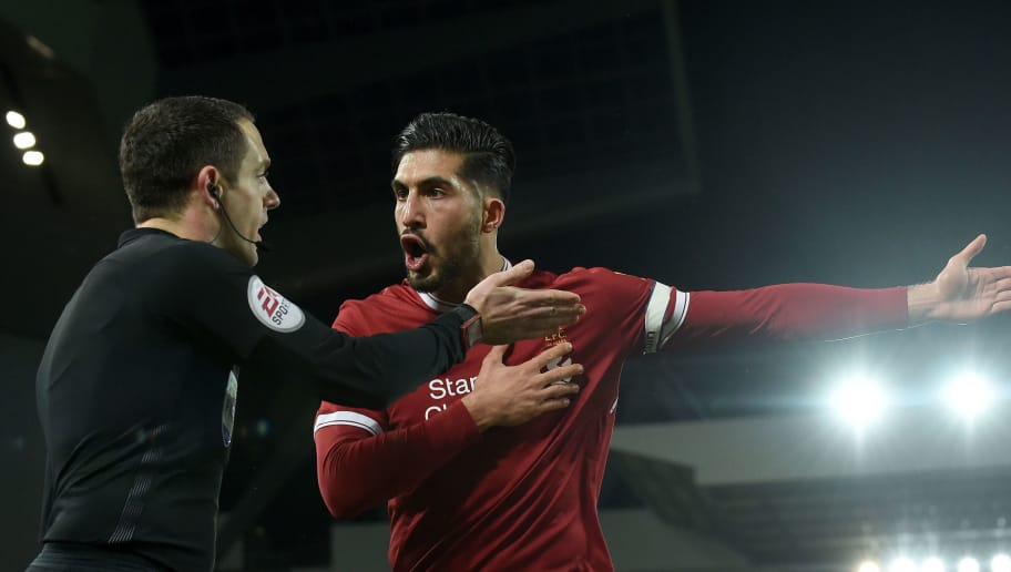 Liverpool's German midfielder Emre Can (R) argues with the linesman after the penalty decision during the English Premier League football match between Liverpool and Tottenham Hotspur at Anfield in Liverpool, north west England on February 4, 2018. / AFP PHOTO / PAUL ELLIS / RESTRICTED TO EDITORIAL USE. No use with unauthorized audio, video, data, fixture lists, club/league logos or 'live' services. Online in-match use limited to 75 images, no video emulation. No use in betting, games or single club/league/player publications.  /         (Photo credit should read PAUL ELLIS/AFP/Getty Images)