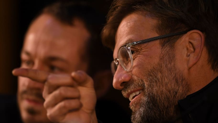 Liverpool's coach German coach Jurgen Klopp gestures during a press conference at the Dragao stadium in Porto, on February 13, 2018, on the eve of their UEFA Champions League football match against FC Porto. / AFP PHOTO / FRANCISCO LEONG        (Photo credit should read FRANCISCO LEONG/AFP/Getty Images)