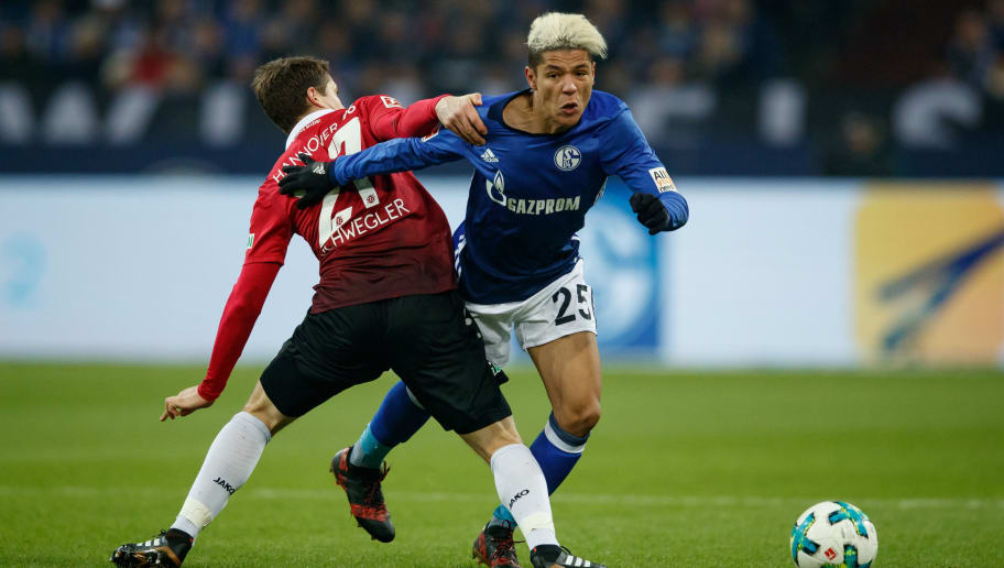 GELSENKIRCHEN, GERMANY - JANUARY 21:  Pirmin Schwegler of Hannover challenges Amine Harit of Schalke  during the Bundesliga match between FC Schalke 04 and Hannover 96 at Veltins-Arena on January 21, 2018 in Gelsenkirchen, Germany.  (Photo by Lars Baron/Bongarts/Getty Images)