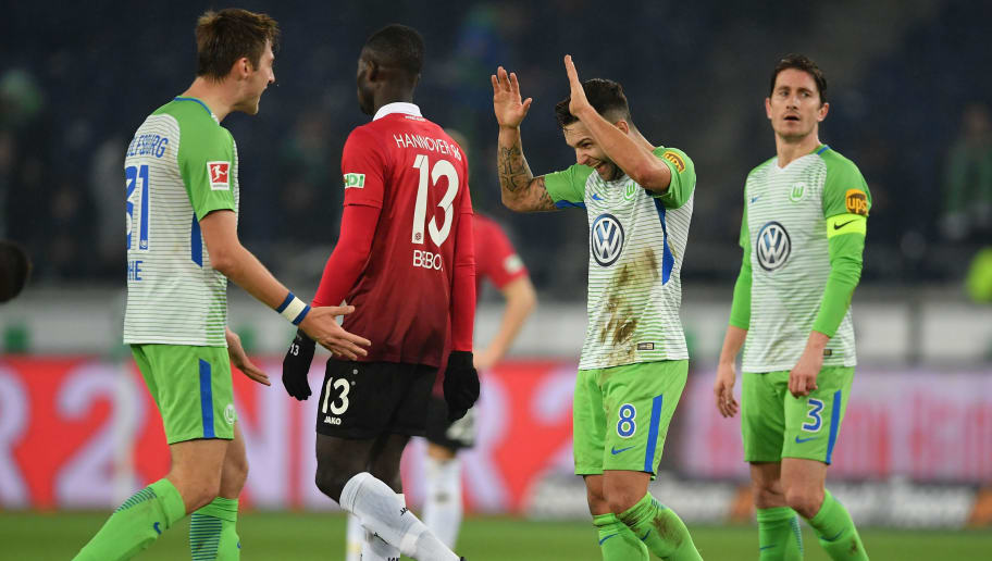 HANOVER, GERMANY - JANUARY 28:  Renato Steffen and Robin Knoche of Wolfsburg celebrate after the Bundesliga match between Hannover 96 and VfL Wolfsburg at HDI-Arena on January 28, 2018 in Hanover, Germany.  (Photo by Stuart Franklin/Bongarts/Getty Images)