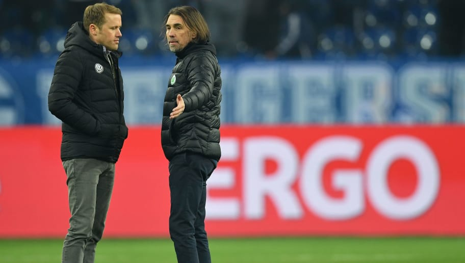 GELSENKIRCHEN, GERMANY - FEBRUARY 07:  Olaf Rebbe;, sports diector and Martin Schmidt, head coach of Wolfsburg  discuss after the DFB Pokal quarter final match between FC Schalke 04 and VfL Wolfsburg at Veltins-Arena on February 7, 2018 in Gelsenkirchen, Germany.  (Photo by Stuart Franklin/Bongarts/Getty Images)