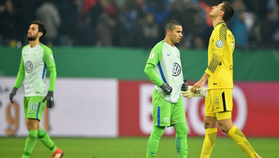 GELSENKIRCHEN, GERMANY - FEBRUARY 07:  William and Koen Casteels of Wolfsburg look dejected after the DFB Pokal quarter final match between FC Schalke 04 and VfL Wolfsburg at Veltins-Arena on February 7, 2018 in Gelsenkirchen, Germany.  (Photo by Stuart Franklin/Bongarts/Getty Images)