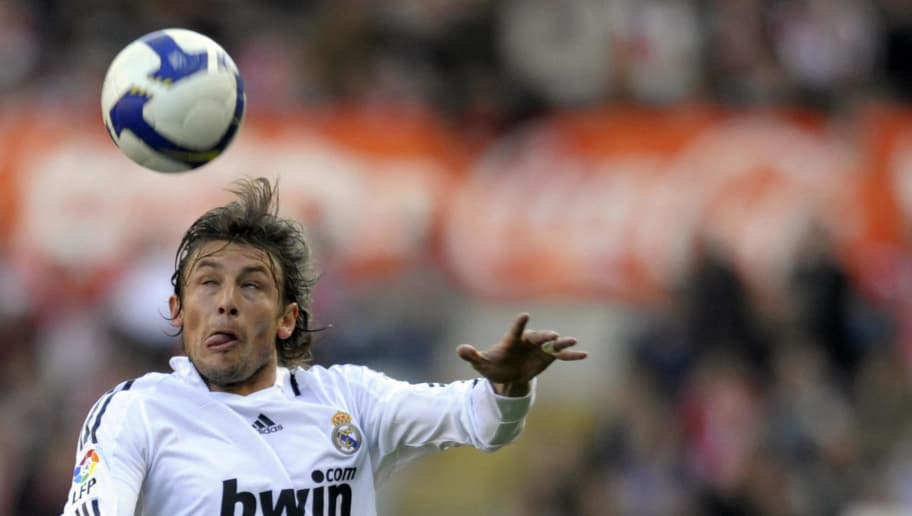 Real Madrid's Argentinian Gabriel Heinze heads the  ball during a Spanish league football match against Sporting Gijon at the Molinon Stadium in Gijon, on February 15, 2009. Real Madrid won the match 4-0. AFP PHOTO / MIGUEL RIOPA (Photo credit should read MIGUEL RIOPA/AFP/Getty Images)