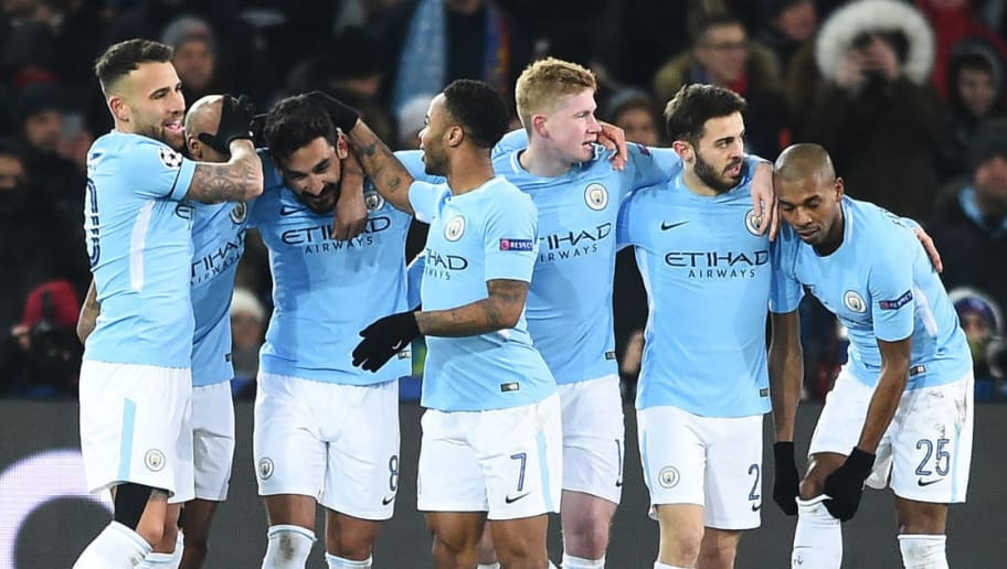 TOPSHOT - Manchester City's German midfielder Ilkay Gundogan (3rd L) celebrates with teammates after scoring his second goal during the UEFA Champions League round of 16 first leg football match between Basel and Manchester City at the Saint Jakob-Park Stadium in Basel on February 13, 2018. / AFP PHOTO / SEBASTIEN BOZON        (Photo credit should read SEBASTIEN BOZON/AFP/Getty Images)