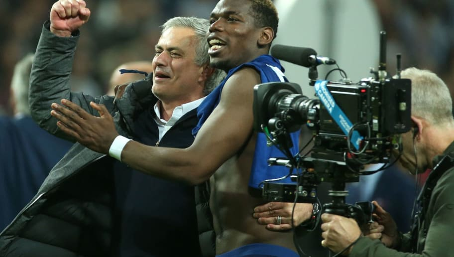 Manchester United's Portuguese manager Jose Mourinho (L) and Manchester United's French midfielder Paul Pogba celebrate after their team won the UEFA Europa League final football match Ajax Amsterdam v Manchester United on May 24, 2017 at the Friends Arena in Solna outside Stockholm. / AFP PHOTO / Soren Andersson        (Photo credit should read SOREN ANDERSSON/AFP/Getty Images)