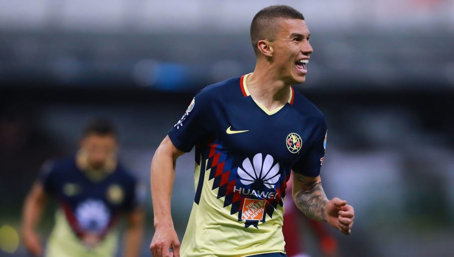 MEXICO CITY, MEXICO - FEBRUARY 13: Mateus Uribe of America celebrates after scoring the third goal of his team during the 7th round match between America and Monarcas as part of the Torneo Clausura 2018 Liga MX at Azteca Stadium on February 13, 2018 in Mexico City, Mexico. (Photo by Hector Vivas/Getty Images)