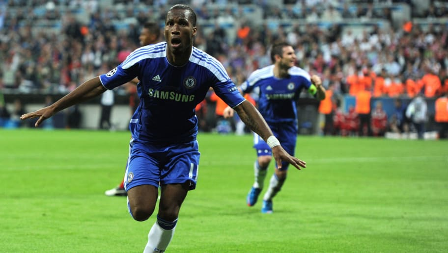 Chelsea's Ivorian forward Didier Drogba celebrates after scoring a goal during the UEFA Champions League final football match between FC Bayern Muenchen and Chelsea FC on May 19, 2012 at the Fussball Arena stadium in Munich.   AFP PHOTO / PATRIK STOLLARZ        (Photo credit should read PATRIK STOLLARZ/AFP/GettyImages)