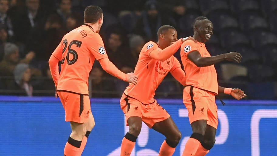 Liverpool's Senegalese midfielder Sadio Mane (R) celebrates with Liverpool's Scottish defender Andrew Robertson (L) and Liverpool's Dutch midfielder Georginio Wijnaldum (C) after scoring the opening goal of the UEFA Champions League round of sixteen first leg football match between FC Porto and Liverpool at the Dragao stadium in Porto, Portugal on February 14, 2018. / AFP PHOTO / Francisco LEONG        (Photo credit should read FRANCISCO LEONG/AFP/Getty Images)