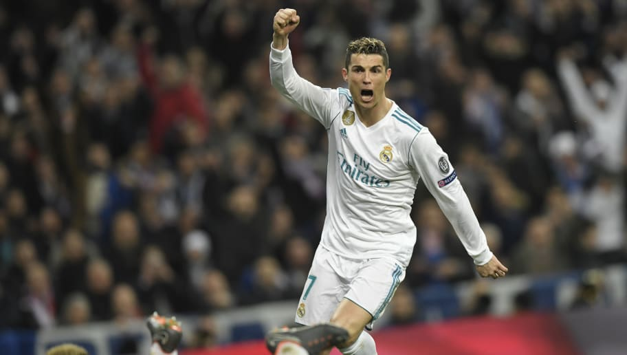 Real Madrid's Portuguese forward Cristiano Ronaldo celebrates after scoring his second goal during the UEFA Champions League round of sixteen first leg football match Real Madrid CF against Paris Saint-Germain (PSG) at the Santiago Bernabeu stadium in Madrid on February 14, 2018.   / AFP PHOTO / GABRIEL BOUYS        (Photo credit should read GABRIEL BOUYS/AFP/Getty Images)
