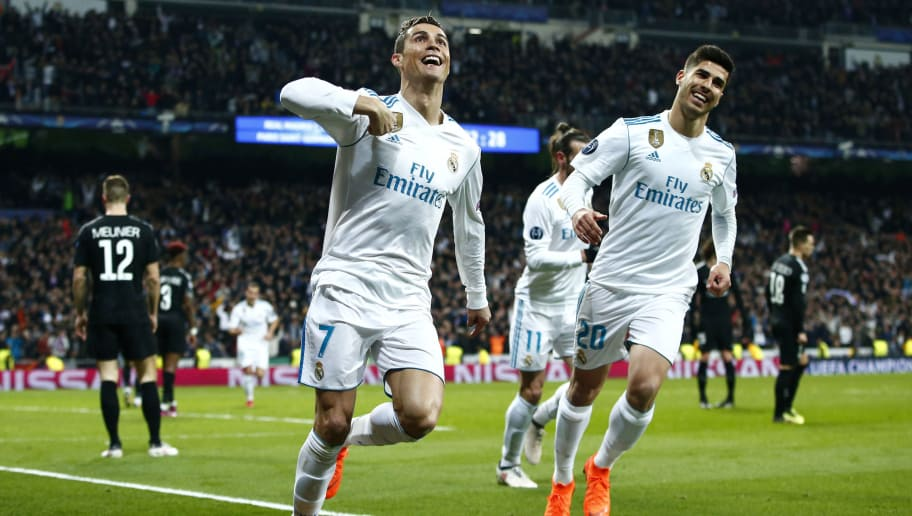 MADRID, SPAIN - FEBRUARY 14:  Cristiano Ronaldo of Real Madrid celebrates scoring the 2nd Real Madrid goal with Marco Asensio of Real Madrid during the UEFA Champions League Round of 16 First Leg match between Real Madrid and Paris Saint-Germain at Bernabeu on February 14, 2018 in Madrid, Spain.  (Photo by Gonzalo Arroyo Moreno/Getty Images)