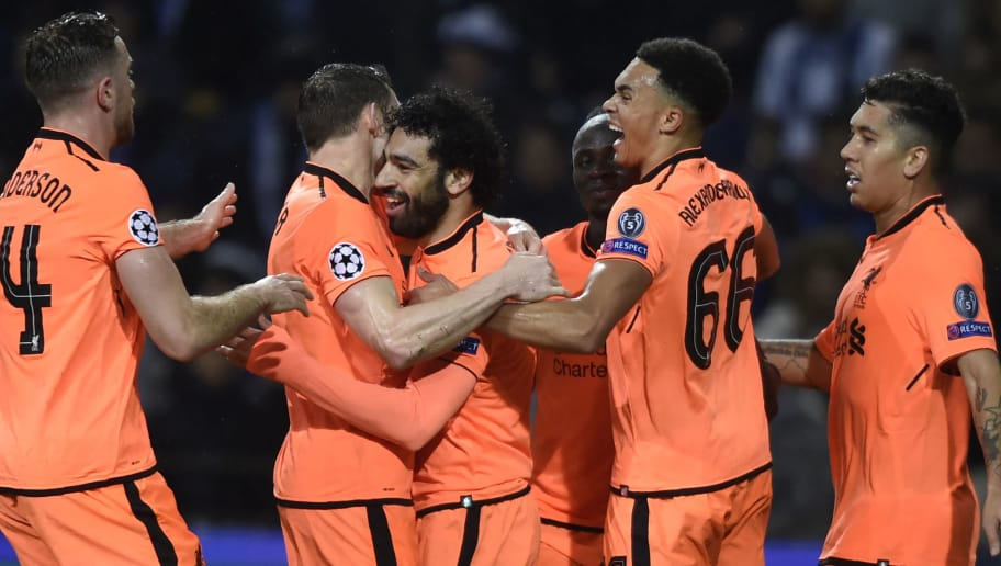 Liverpool's Egyptian midfielder Mohamed Salah (C) celebrates with teammates after scoring their second goal during the UEFA Champions League round of sixteen first leg football match between FC Porto and Liverpool at the Dragao stadium in Porto, Portugal on February 14, 2018. / AFP PHOTO / MIGUEL RIOPA        (Photo credit should read MIGUEL RIOPA/AFP/Getty Images)