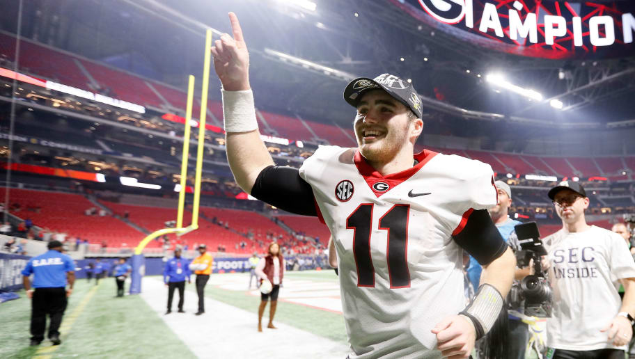 ATLANTA, GA - DECEMBER 02: Jake Fromm #11 of the Georgia Bulldogs celebrates beating Auburn Tigers in the SEC Championship at Mercedes-Benz Stadium on December 2, 2017 in Atlanta, Georgia. (Photo by Jamie Squire/Getty Images)