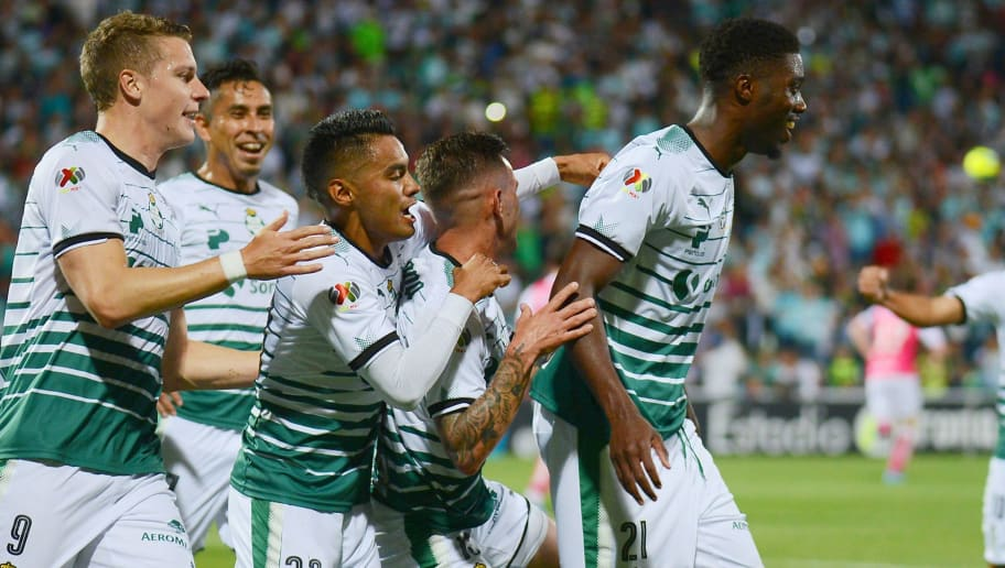Santos's player Jorge Tavares (R) celebrates with teammates his goal against Leon during their Mexican Clausura tournament football match at the TSM Corona stadium, in Torreon, Mexico, on February 14, 2018. / AFP PHOTO / OSCAR WONG        (Photo credit should read OSCAR WONG/AFP/Getty Images)