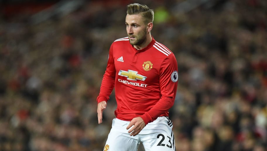 Manchester United's English defender Luke Shaw prepares to pass the ball during the English Premier League football match between Manchester United and Southampton at Old Trafford in Manchester, north west England, on December 30, 2017. / AFP PHOTO / Oli SCARFF / RESTRICTED TO EDITORIAL USE. No use with unauthorized audio, video, data, fixture lists, club/league logos or 'live' services. Online in-match use limited to 75 images, no video emulation. No use in betting, games or single club/league/player publications.  /         (Photo credit should read OLI SCARFF/AFP/Getty Images)