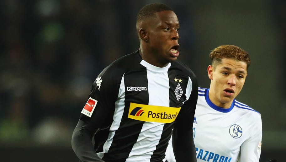 MOENCHENGLADBACH, GERMANY - DECEMBER 09:  Denis Zakaria of Borussia Monchengladbach gets past the tackle from Amine Harit of Schalke 04 during the Bundesliga match between Borussia Moenchengladbach and FC Schalke 04 at Borussia-Park on December 9, 2017 in Moenchengladbach, Germany.  (Photo by Dean Mouhtaropoulos/Bongarts/Getty Images)