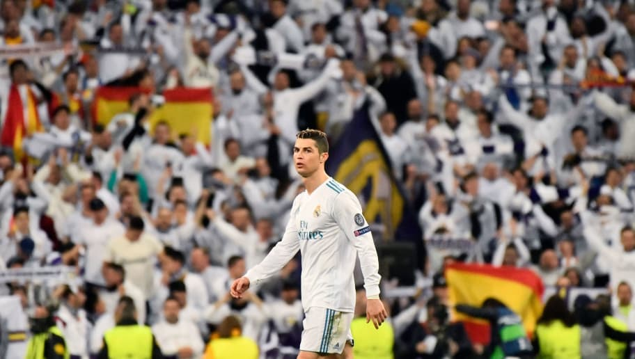 Real Madrid's Portuguese forward Cristiano Ronaldo reacts during the UEFA Champions League round of sixteen first leg football match Real Madrid CF against Paris Saint-Germain (PSG) at the Santiago Bernabeu stadium in Madrid on February 14, 2018.   / AFP PHOTO / CHRISTOPHE SIMON        (Photo credit should read CHRISTOPHE SIMON/AFP/Getty Images)