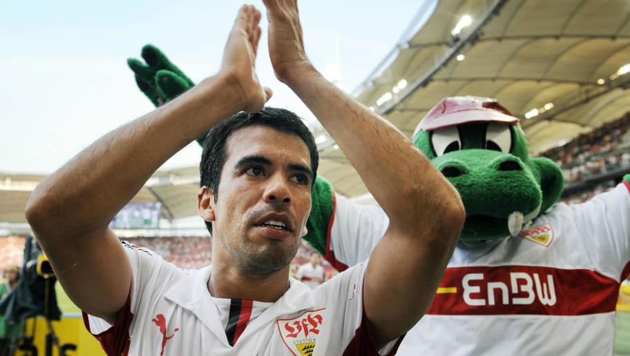 RESTRICTIONS / EMBARGO - ONLINE CLIENTS MAY USE UP TO SIX IMAGES DURING EACH MATCH WITHOUT THE AUTHORISATION OF THE DFL. NO MOBILE USE DURING THE MATCH AND FOR A FURTHER TWO HOURS AFTERWARDS IS PERMITTED WITHOUT THE AUTHORISATION OF THE DFL. Stuttgart's Mexican midfielder Pavel Pardo applauds beside the club's mascot after the German first division Bundesliga football match VfB Stuttgart vs Hanover 96 at the in the southern German city of Stuttgart on August 31, 2008. Stuttgart won the match 2-0.    AFP PHOTO    DDP / THOMAS LOHNES GERMANY OUT (Photo credit should read THOMAS LOHNES/AFP/Getty Images)