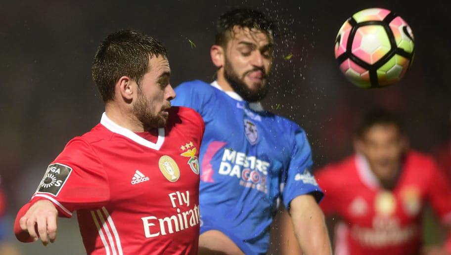 Benfica's Serbian forward Andrija Zivkovic (L) vies with Feirense's defender Vitor Bruno  during the Portuguese league football match CD Feirense vs SL Benfica at the Marcolino de Castro stadium in Santa Maria da Feira on March 4, 2017. / AFP PHOTO / MIGUEL RIOPA        (Photo credit should read MIGUEL RIOPA/AFP/Getty Images)