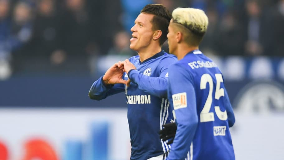 Schalke's Ukrainian midfielder Yevhen Konoplyanka (L) celebrates after scoring during the German first division Bundesliga football match Schalke 04 versus Werder Bremen on February 3, 2018 in Gelsenkirchen. / AFP PHOTO / Patrik STOLLARZ / RESTRICTIONS: DURING MATCH TIME: DFL RULES TO LIMIT THE ONLINE USAGE TO 15 PICTURES PER MATCH AND FORBID IMAGE SEQUENCES TO SIMULATE VIDEO. == RESTRICTED TO EDITORIAL USE == FOR FURTHER QUERIES PLEASE CONTACT DFL DIRECTLY AT + 49 69 650050         (Photo credit should read PATRIK STOLLARZ/AFP/Getty Images)
