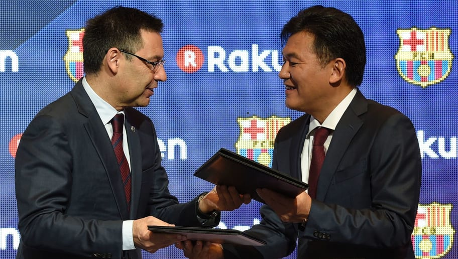 CEO of Japanese company Rakuten Hiroshi Mikitani (R) exchanges documents with Barcelona's president Josep Maria Bartomeu after signing an agreement between FC Barcelona and its new sponsor Rakuten Inc., at Camp Nou stadium in Barcelona on November 16, 2016. Japanese online retailer Rakuten will be Barcelona's main sponsor for the next four years, the Spanish giants said on Npovember 16, 2016. Rakuten will replace Qatar Airways which has been Barcelona's shirt sponsor since 2013.  / AFP / LLUIS GENE        (Photo credit should read LLUIS GENE/AFP/Getty Images)
