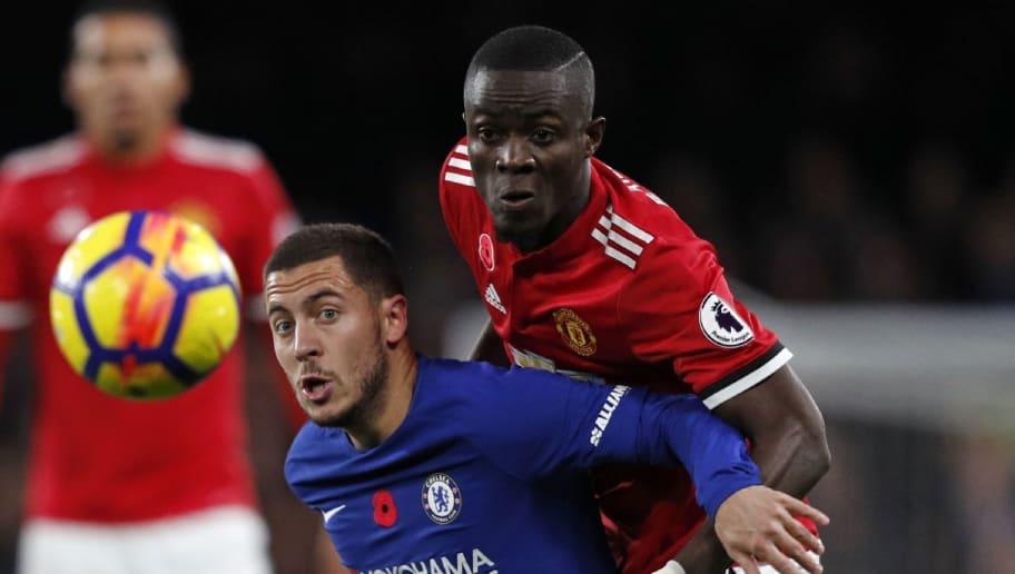 Manchester United's Ivorian defender Eric Bailly (R) vies with Chelsea's Belgian midfielder Eden Hazard during the English Premier League football match between Chelsea and Manchester United at Stamford Bridge in London on November 5, 2017. / AFP PHOTO / Adrian DENNIS / RESTRICTED TO EDITORIAL USE. No use with unauthorized audio, video, data, fixture lists, club/league logos or 'live' services. Online in-match use limited to 75 images, no video emulation. No use in betting, games or single club/league/player publications.  /         (Photo credit should read ADRIAN DENNIS/AFP/Getty Images)