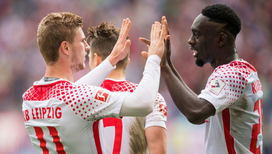 Leipzig´s forward Timo Werner (L) celebrates scoring with French forward Jean-Kevin Augustin during the German dirst division Bundesliga football match between RB Leipzig and Eintracht Frankfurt in Leipzig, eastern Germany, on September 23, 2017. / AFP PHOTO / ROBERT MICHAEL / RESTRICTIONS: DURING MATCH TIME: DFL RULES TO LIMIT THE ONLINE USAGE TO 15 PICTURES PER MATCH AND FORBID IMAGE SEQUENCES TO SIMULATE VIDEO. == RESTRICTED TO EDITORIAL USE == FOR FURTHER QUERIES PLEASE CONTACT DFL DIRECTLY AT + 49 69 650050         (Photo credit should read ROBERT MICHAEL/AFP/Getty Images)