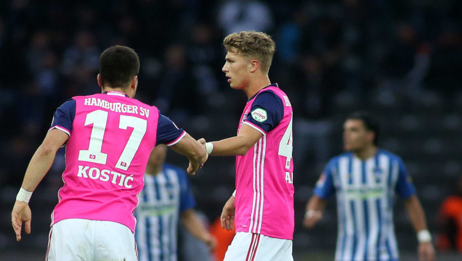 BERLIN, GERMANY - OCTOBER 28: Aaron Hunt (L), Filip Kostic (M) and Jann-Fiete Arp (R)  of Hamburger SV celebrates their teams first goal scoring during the Bundesliga match between Hertha BSC and Hamburger SV at Olympiastadion on October 28, 2017 in Berlin, Germany. (Photo by Selim Sudheimer/Bongarts/Getty Images )